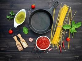 Spaghetti ingredients with a cast iron skillet