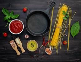 Cast iron skill and spaghetti ingredients