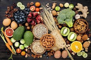 Top view of healthy foods on a black background
