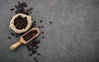 Dark roasted coffee on dark concrete photo