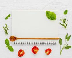 Blank spiral notebook with fresh ingredients