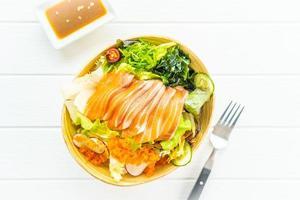 Raw fresh salmon sashimi with seaweed and other vegetables