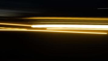Blurred light or light trails and black background