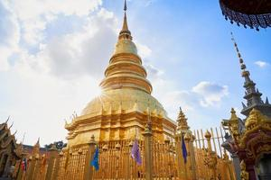 Wat Phra That Hariphunchai temple cloudy blue sky photo