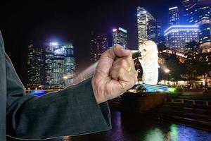 Man's fist superimposed on night city skyline