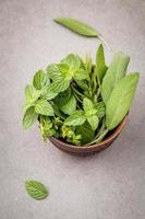 Green herbs in a wood bowl