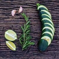 Lime, rosemary and cucumber slices