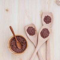 Flax seeds in a bowl and spoons photo