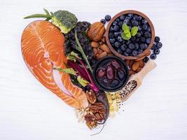 Salmon and fresh ingredients in a heart shape photo