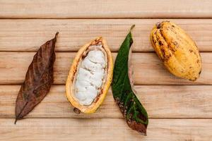 Cocoa pods on wooden table