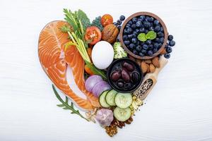 Health foods in a heart shape photo