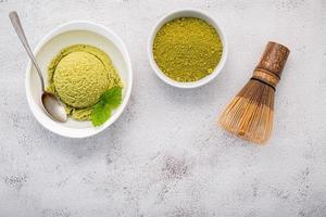 Green tea ice cream on concrete