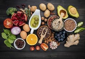 Flat lay of fresh ingredients on dark wood