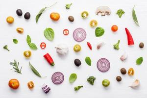 Fresh veggies and herbs on white photo