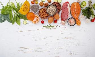 Fresh healthy ingredients on shabby white background