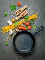 Cast iron skillet with ingredients for spaghetti