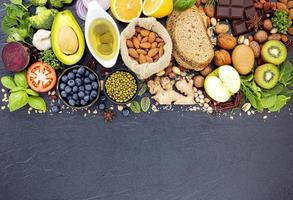Healthy foods flat lay on dark slate photo