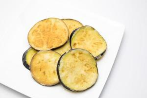 Fried eggplant slices on white background