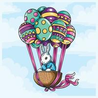 Easter bunny in basket with flying balloon eggs vector