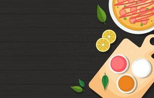 Pizza and Ingredients on Cutting Board on Kitchen Table vector