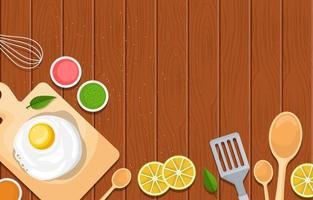 Huevo a bordo con equipo de cocina y fruta en la cocina como telón de fondo vector