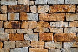 Fondo de textura de pared de piedra naranja foto