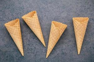 Waffle cones on a gray background