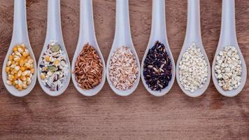 Spoons of different grains photo