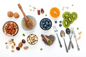 Fruit and nuts with silverware photo