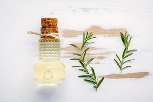 Bottle of extra virgin olive oil with rosemary photo
