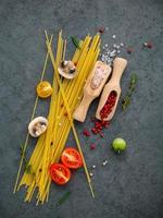 Spaghetti ingredients on dark gray
