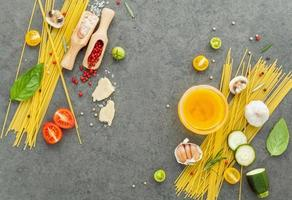 Fresh spaghetti ingredients on a gray background