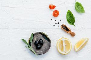 Top view of Italian ingredients on a shabby white background photo