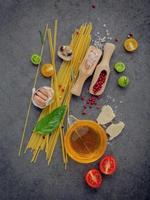 Spaghetti ingredients on a dark gray background