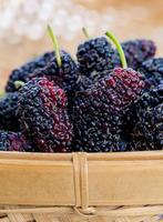 Ripe mulberries in a wicker basket