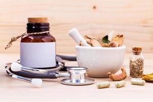 Herbal alternative medicine on wood photo