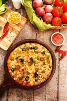 Vegetarian pizza with wooden background photo