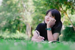 Girl sitting in the garden thinking thinking