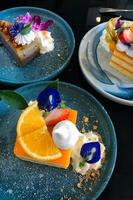 Orange cake with orange topping on plate ready to eat