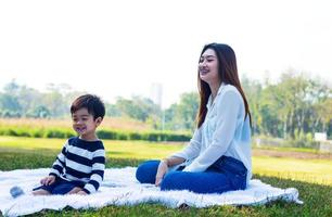 Asian mother and son happily in the park