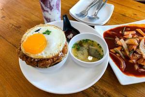 Korean food kimchi fried rice and fried egg photo