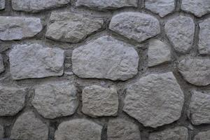 Stonewall texture, decorative wall background with mosaic stones