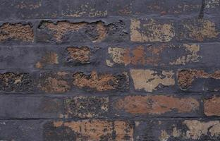 Old horizontal grungy texture brick background. Structure with stucco and broken cap
