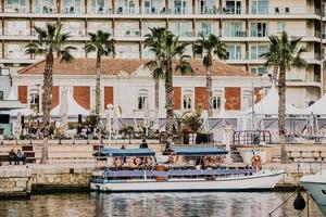 Spain, 2018- Waterfront tourists visit a mediterranean neighborhood in Spain
