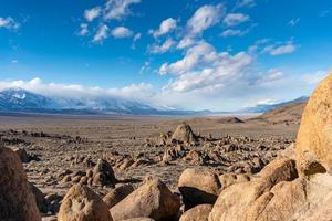 Rock formations across vast mountain landscape