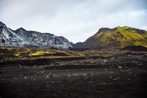 Gray and yellow mountain range across volcanic landscape