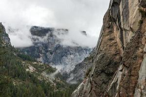 Granite mountain against cloudy winter landscape in Yosemite