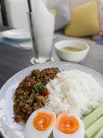 Thaifood basil chicken with boiled egg photo