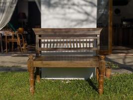 Brown wooden bench in garden