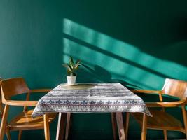 Table of free space with green plant